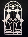 Two angels. Paper cutting Stock Photos