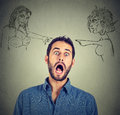 Two angry women blaming scared young man Royalty Free Stock Photo