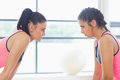 Two angry women staring at each other at a gym Royalty Free Stock Image