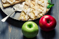 Two apples and freshly baked apple pie Royalty Free Stock Photo