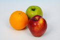 Two apples and an orange. Royalty Free Stock Photo