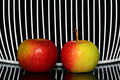 Two apples three on a line with net in background Stock Photo