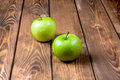 Two apples on a wooden background green brown Stock Photography