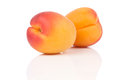 Two apricots isolated on white Royalty Free Stock Photos