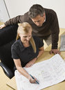 Two architects and the drawing Royalty Free Stock Photo