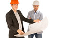 Two architects studying a building blueprint Royalty Free Stock Photo