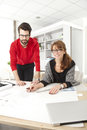 Two architects working at desk in studio small business Royalty Free Stock Images