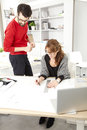 Two architects working at desk in studio small business Stock Image