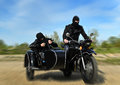 Two armed men riding a motorcycle Stock Photos