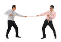 Two asian businessmen pulling a rope full body isolated on white background male model Royalty Free Stock Images