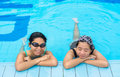 Two asian girls are relaxing in the swimming pool corner for holiday Royalty Free Stock Photography