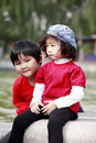 Two Asian little girl outdoors Royalty Free Stock Images