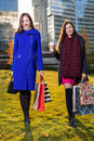 Two Asian woman holding shopping bags in hand Royalty Free Stock Photo