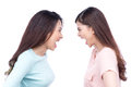 Two asian women shouting each other against white background. Royalty Free Stock Photo