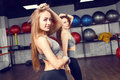 Two athletic girls training in fitness center Royalty Free Stock Photo