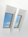 Two attic windows blue sky view Stock Images