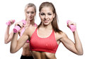 Two attractive athletic girl with dumbbells Royalty Free Stock Photo