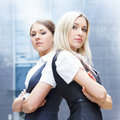 Two attractive business women in formal clothes Royalty Free Stock Photo