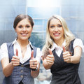 Two attractive business women in formal clothes Stock Image