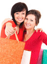 Two attractive girls after shopping holding bags white background Royalty Free Stock Images