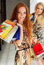 Two attractive happy girls out shopping smiling teenager Stock Images