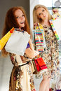 Two attractive happy girls out shopping teenager in mall Stock Image