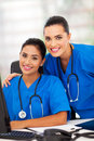Two attractive modern female healthcare workers office Royalty Free Stock Photography