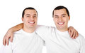 Two attractive positive smiling young men twins Stock Image