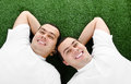 Two attractive smiling young men twins Royalty Free Stock Image
