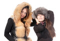 Two attractive women dressed for winter Royalty Free Stock Photography