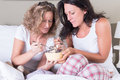 Two attractive women enjoying their women s evening in bed Royalty Free Stock Photos