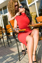 Two attractive women in street cafe Royalty Free Stock Images