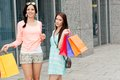 Two attractive young girls women on shopping tour Stock Photography