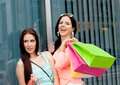 Two attractive young girls women on shopping tour Stock Images