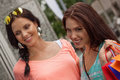 Two attractive young girls women on shopping tour outdoor city summer Stock Photos