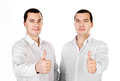 Two attractive young men twins with thumbs up Stock Photography