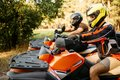 Two atv riders before the trip in summer forest Royalty Free Stock Photo