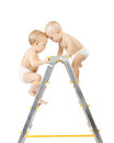 Two babies climbing and fighting on stepladder Stock Images