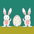 Two Baby Easter bunnies with egg Stock Photos