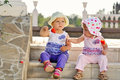 Two baby friends sitting on the stairs Stock Image