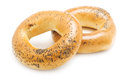 Two bagels with poppy seeds on a white background Royalty Free Stock Images