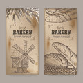 Two bakery label templates with wooden windmill, wheat and bread on vintage background