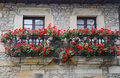 Two balconies decorated with pots of geraniums in a typical house northern spain Stock Images