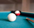 Two balls and a cue billiards close up Royalty Free Stock Image