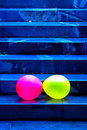 Two Baloons Falling Down The Stairs Royalty Free Stock Photo
