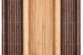 Two bamboo mat twisted in the form of manuscript  on white background Royalty Free Stock Photo