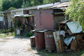 Two barrels and old shed in front of rusty Royalty Free Stock Images