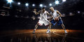 Two basketball players in action Royalty Free Stock Photo