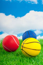 Two basketballs and a tennisball Royalty Free Stock Photos