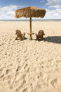 Two Beach Chairs and Umbrella on Beautiful Ocean Sand Royalty Free Stock Images
